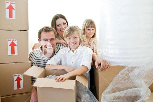 Loving family packing boxes