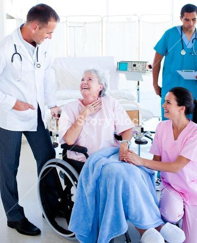 Confident medical team taking care of a senior woman
