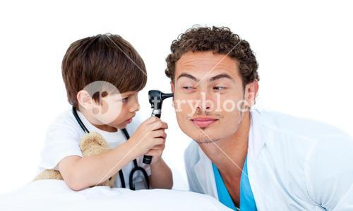 Little boy examining a male doctor
