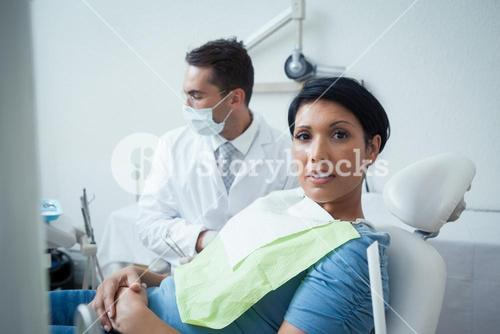 Serious woman waiting for dental exam