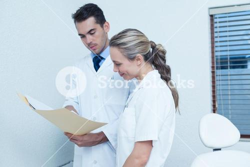 Dentists discussing reports