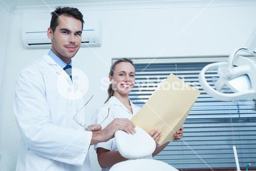 Portrait of dentists with reports