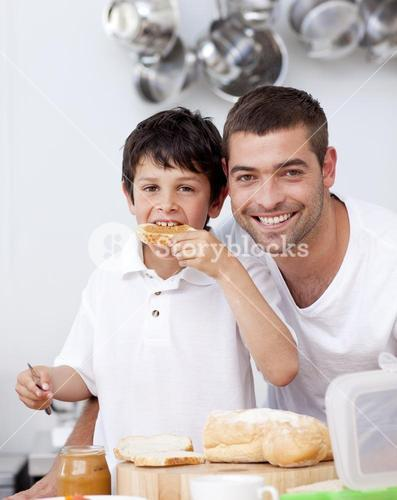 Father and son eating a toast