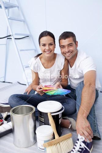 Couple with colour samples to paint new appartment