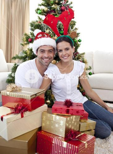 Happy couple celebrating Christmas at home