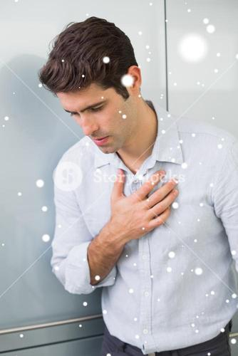 Composite image of casual young man with chest pain