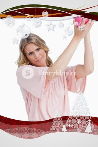 Composite image of disappointed woman holds a piggy bank up over her head