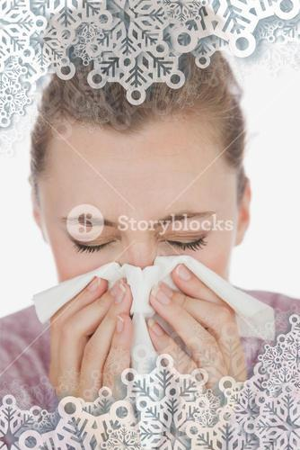 Composite image of woman blowing nose
