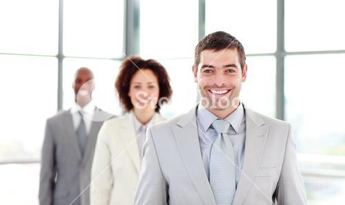Smiling businessman leading his colleagues