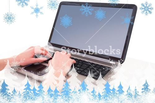 Composite image of hands typing on laptop