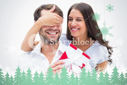 Composite image of pretty brunette surprising boyfriend with a gift