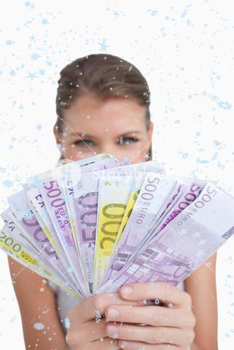 Composite image of portrait of a cute woman showing bank notes