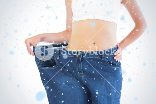 Composite image of close up of confident slender blonde wearing too big trousers