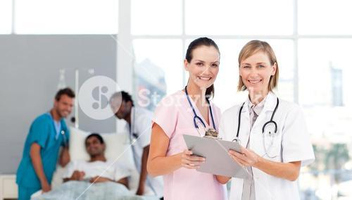 Attractive doctors attending to a patient
