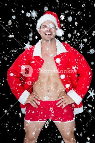 Composite image of smiling muscular man posing in sexy santa outfit