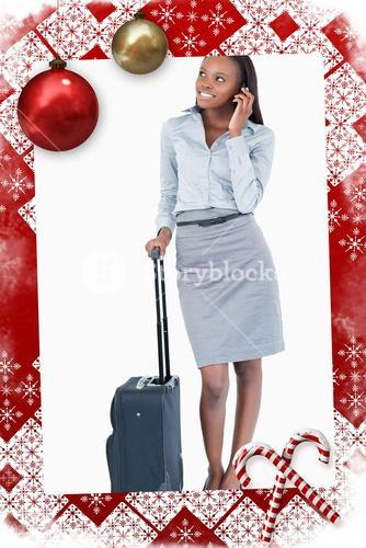 Composite image of portrait of a cute businesswoman with a suitcase making a phone call