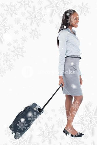 Composite image of portrait of a businesswoman walking with a suitcase