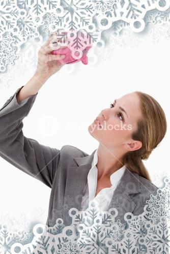 Composite image of bank employee looking at piggy bank