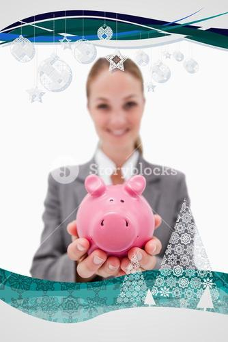 Composite image of piggy bank being offered by smiling bank employee