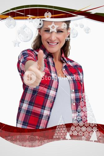 Composite image of portrait of a blissful woman with the thumb up