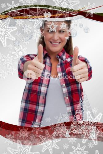 Composite image of portrait of a blissful woman with the thumbs up