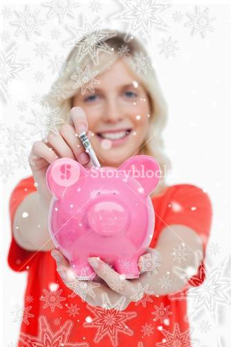 Composite image of piggy bank getting dollar notes from a young woman