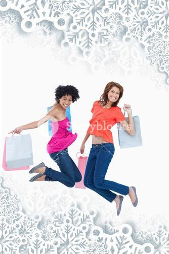 Composite image of young teenagers energetically jumping after going shopping