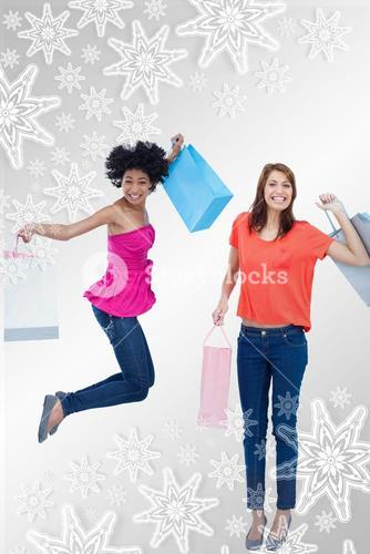 Composite image of a teenage girl jumping with her shopping bags while her friend is standing up
