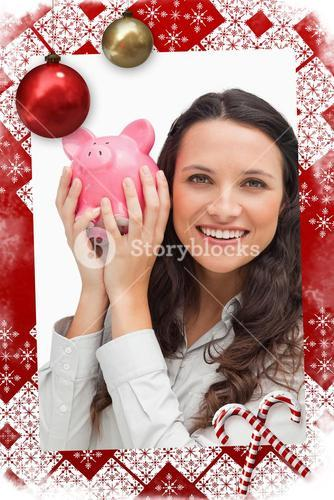 Composite image of portrait of a brunette shaking a piggy bank
