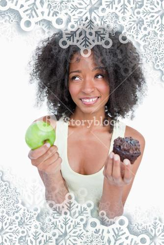 Composite image of young woman looking up to ask for help to choose between a fruit and chocolate