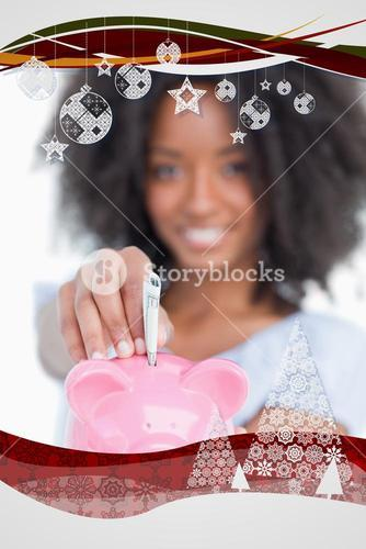 Composite image of young woman inserting notes in a piggy bank