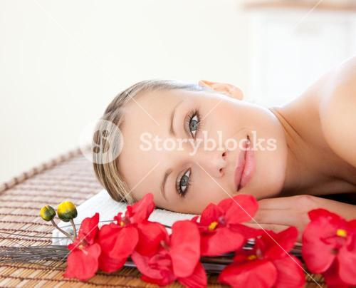 Radiant woman relaxing in a Spa center