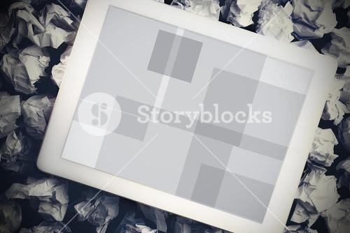 Tablet pc on crumpled paper