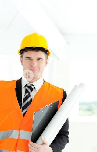 Young male architect holding blueprints