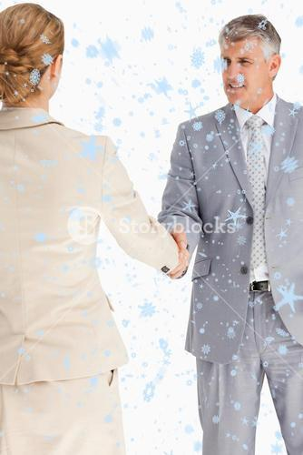 Composite image of business people having an agreement