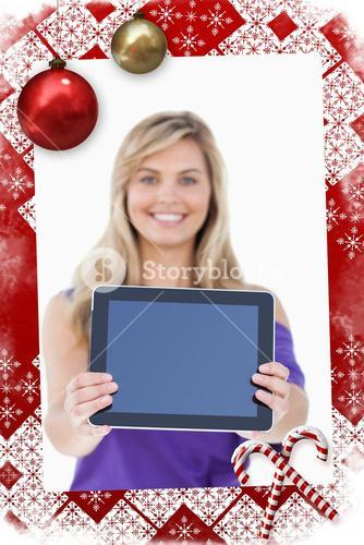 Composite image of tablet computer being held by a blonde woman