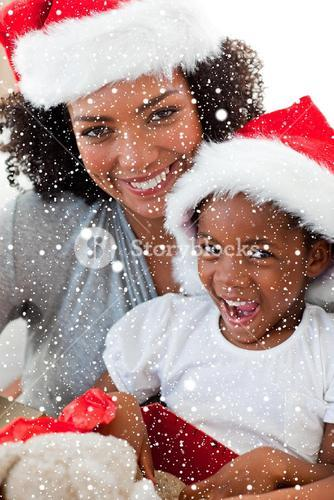 Composite image of mother and daughter having fun at christmas time
