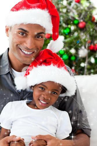 Composite image of father and daughter wearing a christmas hat