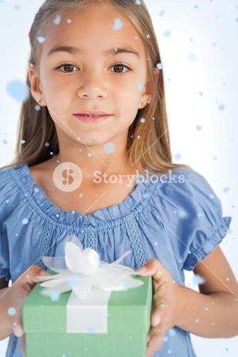 Composite image of portrait of a smiling little girl holding a wrapped gift