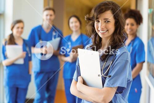 Medical students smiling at the camera