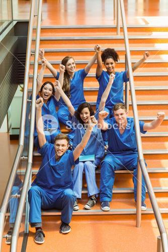 Medical students cheering on the steps