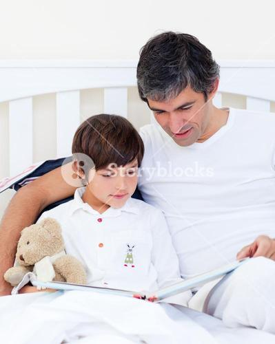 Caring father reading with his son