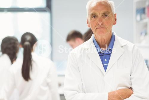Stern lecturer looking at camera in the lab