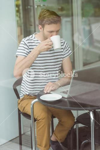 Smiling student drinking hot drink