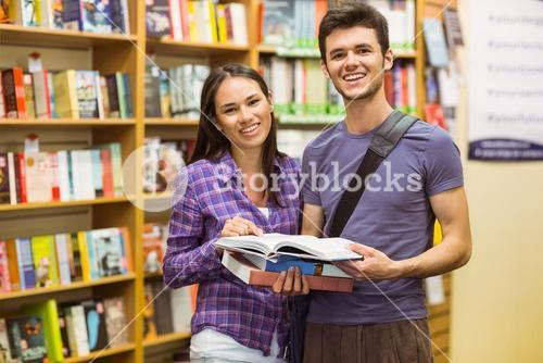 Smiling friends student holding textbook