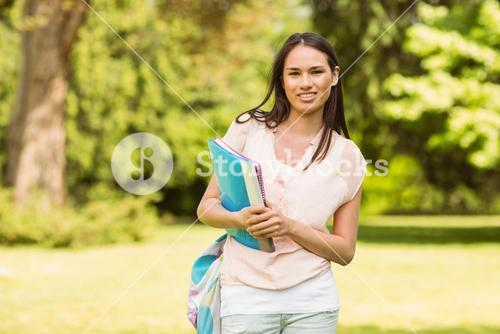 Portrait of an university student holding book