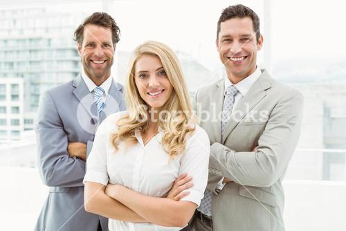 Portrait of young business people in office