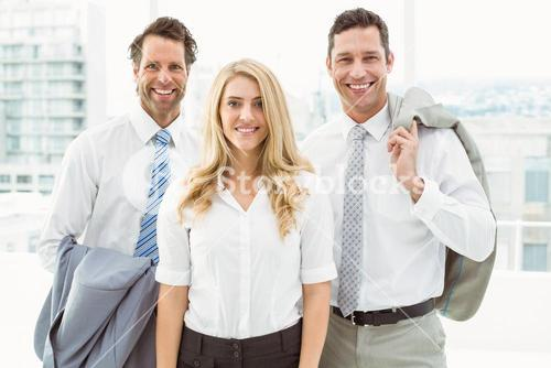 Happy young business people in office