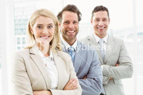 Confident happy young business people in office