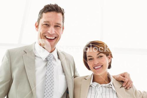 Happy business couple in office